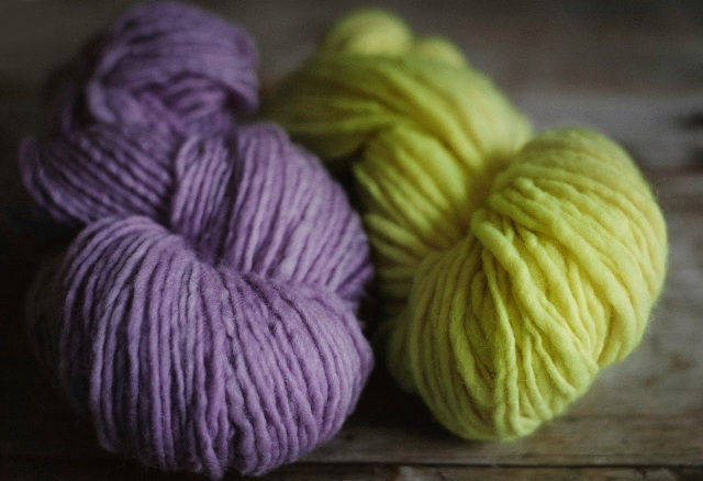 Handspun Pure Wool yarn in purple and neon yellow.