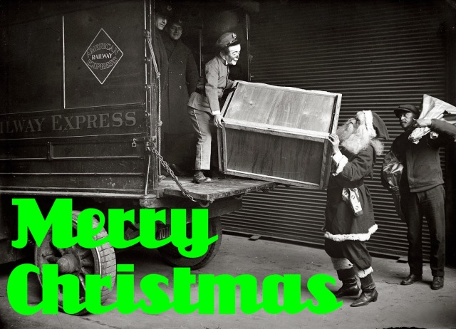 Elf and Santa unloading a truck of presents on Christmas.