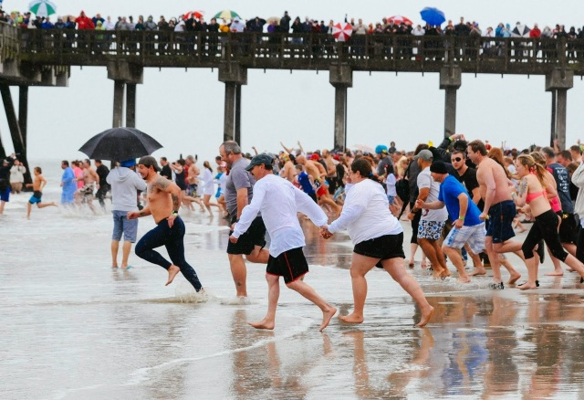 Running into the cold waters for the polar plunge on Tybee Island.