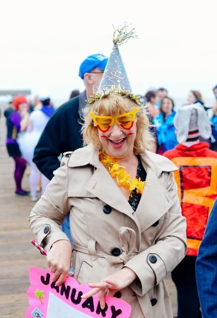 Woman dressed in big birthday hat to take the polar plunge on Tybee Island.