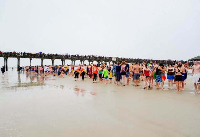 The crowd ready to run into the cold waters for the polar plunge on Tybee Island.