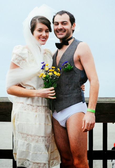 Bride and groom taking the polar plunge on Tybee Island.